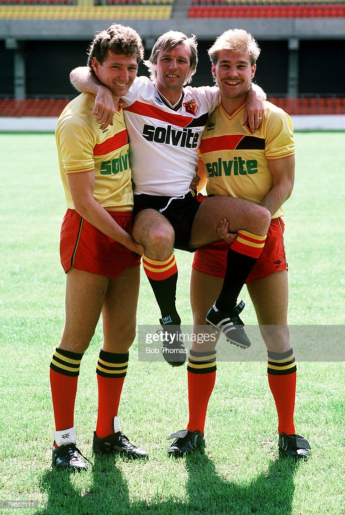 circa 1987, Dave Bassett, Watford Manager hoisted by the new signings Trevor Senior, left, and Richard Hill