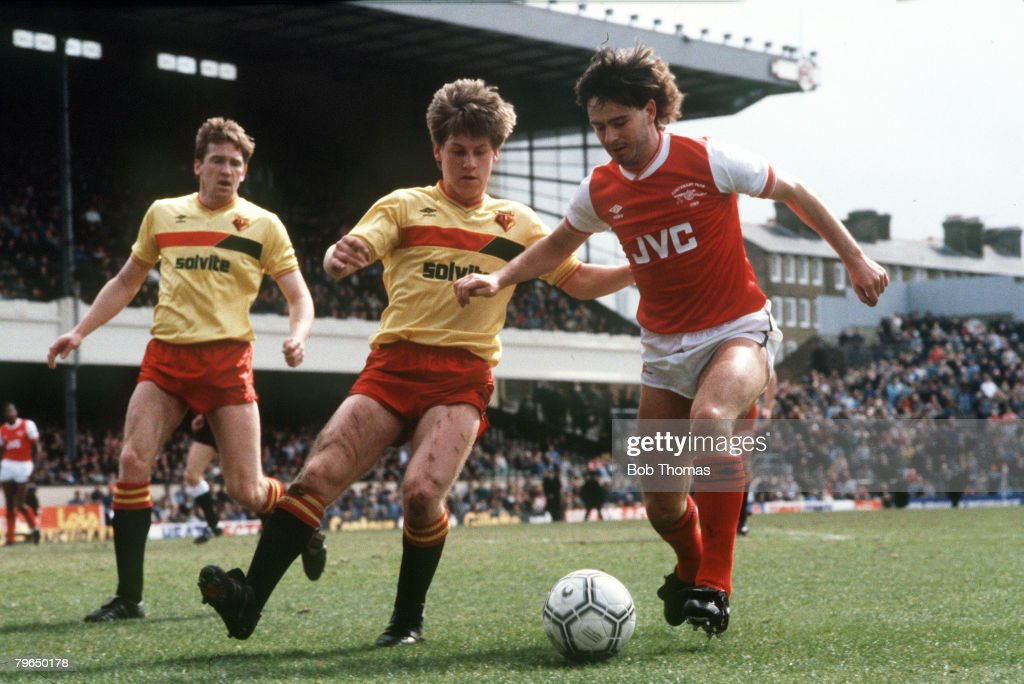 BT Sport, Football, pic: circa 1987, Division 1, Arsenal v Watford at Highbury, Arsenal's Charlie Nicholas, right, under pressure from Watford's Nigel Gibbs : News Photo