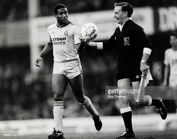 Circa 1988, Liverpool's John Barnes hands the ball back to a smiling linesman, John Barnes played for Liverpool 1987-1997 and in his time at the club...
