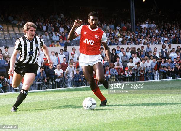 circa 1990 Arsenal's David Rocastle on the ball with Newcastle United's John Anderson challenging