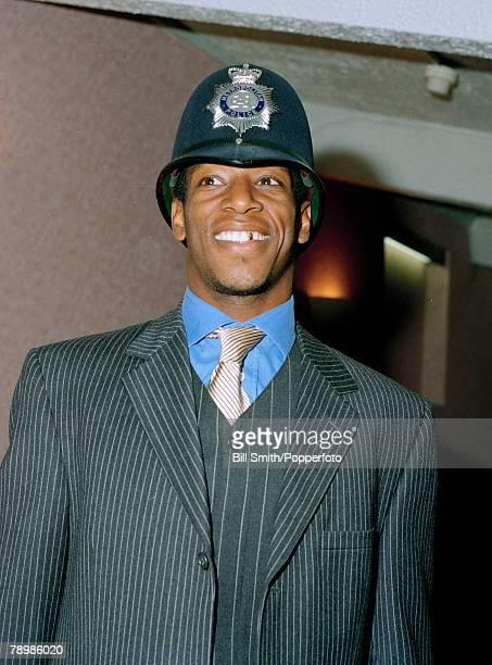 circa 1990s Arsenal striker Ian Wright wearing a policeman's helmet