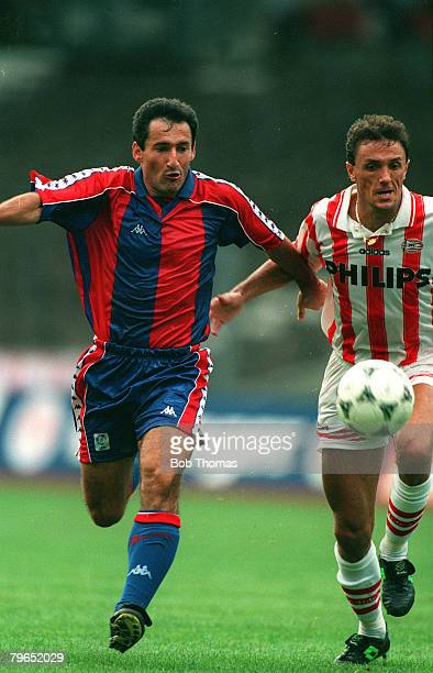 circa 1991 European Football Barcelona's Aitor Begiristain racing with PSV Eindhoven's Gica Popescu