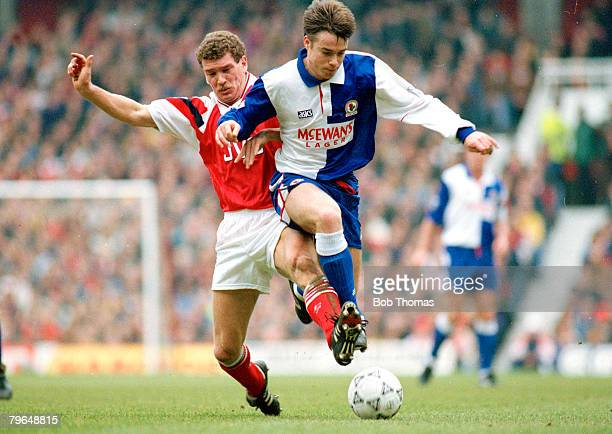 circa 1993 Blackburn Rovers' Graeme Le Saux under pressure from Arsenal's John Jensen left