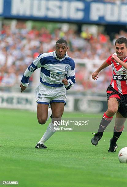 circa 1993 Queens Park Rangers' Andrew Impey races for the ball with Southampton defender Francis Benali right