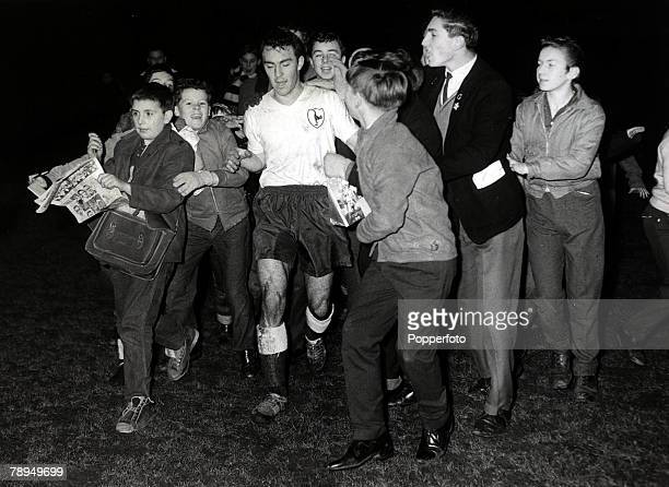 December 1961, Tottenham Hotspur's Jimmy Greaves is mobbed by young fans after his return to English football after a spell with AC Milan.