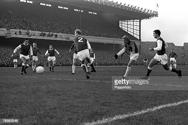 December 1964 Division 1 Arsenal v Manchester United at Highbury Manchester United's Denis Law 2nd right shoots to score