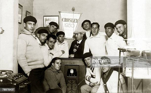July 1930 1930 World Cup Finals in Uruguay The Uruguay team gather around the radio to listen to a report on a first stage match at their training...