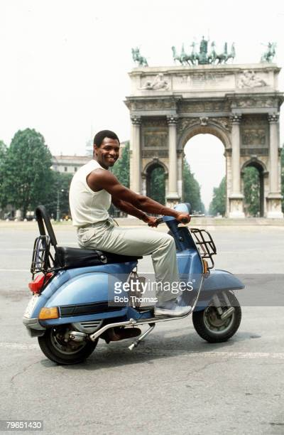 July 1983 AC Milan striker Luther Blissett is pictured riding a Lambretta scooter in the Arco Della Pace Milan shortly after signing for the club