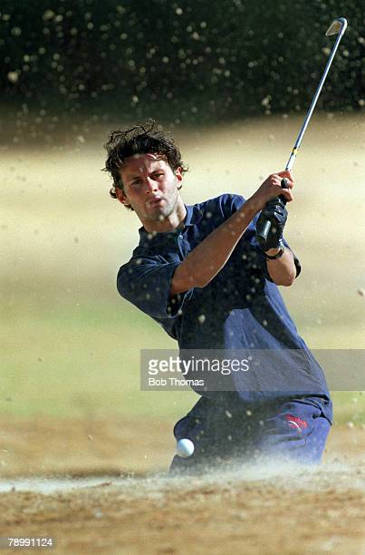 July 1993 Manchester United in South Africa Manchester United's Ryan Giggs relaxing on a golf course as he plays from a bunker