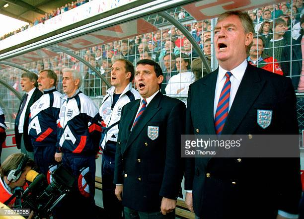 June 1993, The England bench in good voice during the National Anthem with Graham Taylor, England Manager 2nd right and Lawrie McMenemy, right...