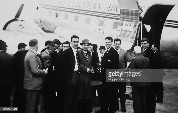 May 1957, The Manchester United party prepare to fly to Denmark on an end of season trip, with pictured centre, Ray Wood and 2nd right, Duncan Edwards