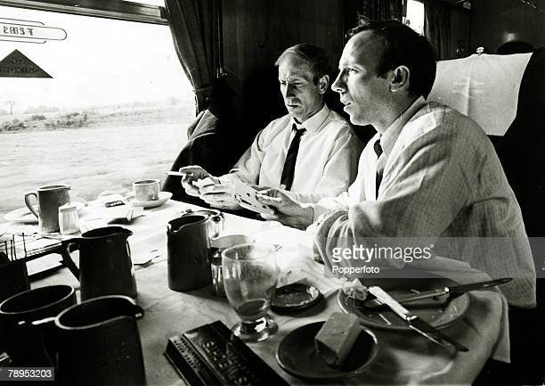 May 1968 Manchester United's Bobby Charlton and Nobby Stiles on the train to London to play Benfica in the 1968 European Cup Final