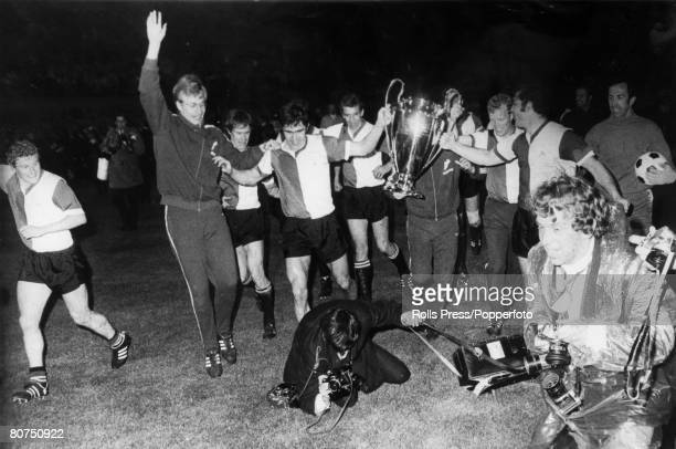 May 1970, European Cup Final in Milan, Feyenoord 2 v Celtic 1, Feyenoord players parade the European Cup as a photographer falls over in the...