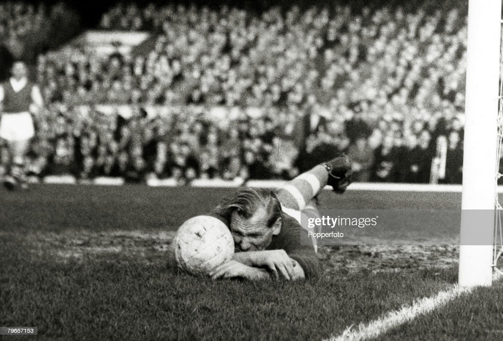 November 1957, Division 1, Arsenal v Manchester City at Highbury, Manchester City goalkeeper Bert Trautman dives along the ground to block the ball, The German born goalkeeper Bert Trautman, famously played on in the 1956 F,A,Cup Final unaware that he had broken his neck