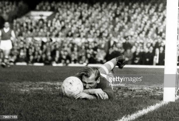 November 1957 Division 1 Arsenal v Manchester City at Highbury Manchester City goalkeeper Bert Trautman dives along the ground to block the ball The...