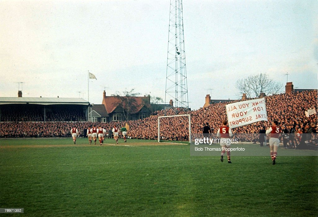 Sport. Football. pic: Season 1964-1965. Northampton Town players parade a banner in front of the Spion Kop at the County Ground thanking the fans for their loyal support as the side celebrate promotion to Division 1. Northampton under the management of Da : News Photo