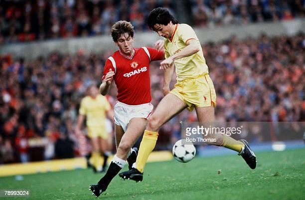 September 1984 Division 1 Manchester United 1 v Liverpool 1 Liverpool's Alan Hansen chased by Manchester United's Norman Whiteside