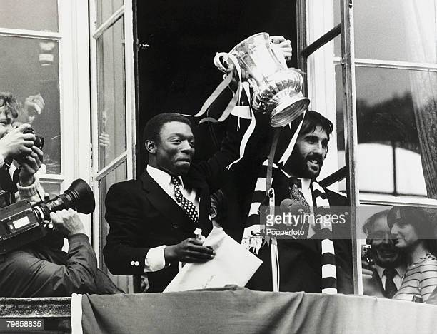 17th May 1981 Tottenham Hotspur's Garth Crooks left and Ricky Villa display the FA Cup to crowds at Tottenhm Town Hall the day after beating...