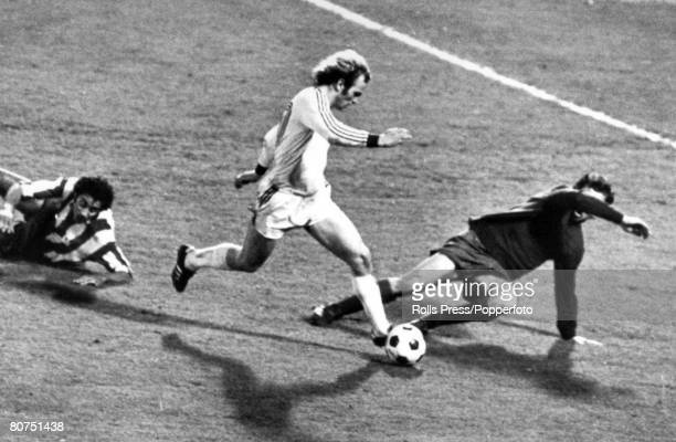 1974 European Cup Final Replay in Brussels Bayern Munich 4 v Athletico Madrid 0 Bayern Munich's Uli Hoeness takes the ball around Madrid goalkeeper...