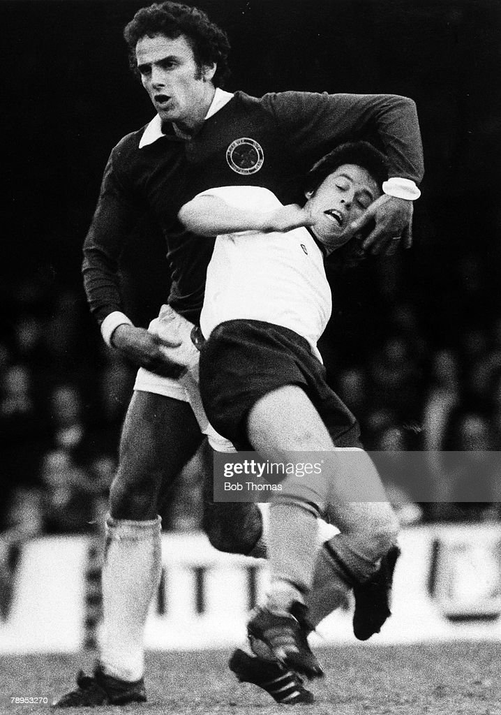 Sport. Football. pic:1976. Division 1. Leicester City v Burnley. Burnley midfielder Brian Flynn stumbles as he is held by Leicester City's Steve Earle. : News Photo