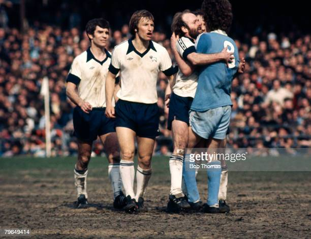 circa 1977 Derby County's Archie Gemmill and Manchester City's Brian Kidd grab each other in a confrontation as Derby's Colin Todd centrevoices his...