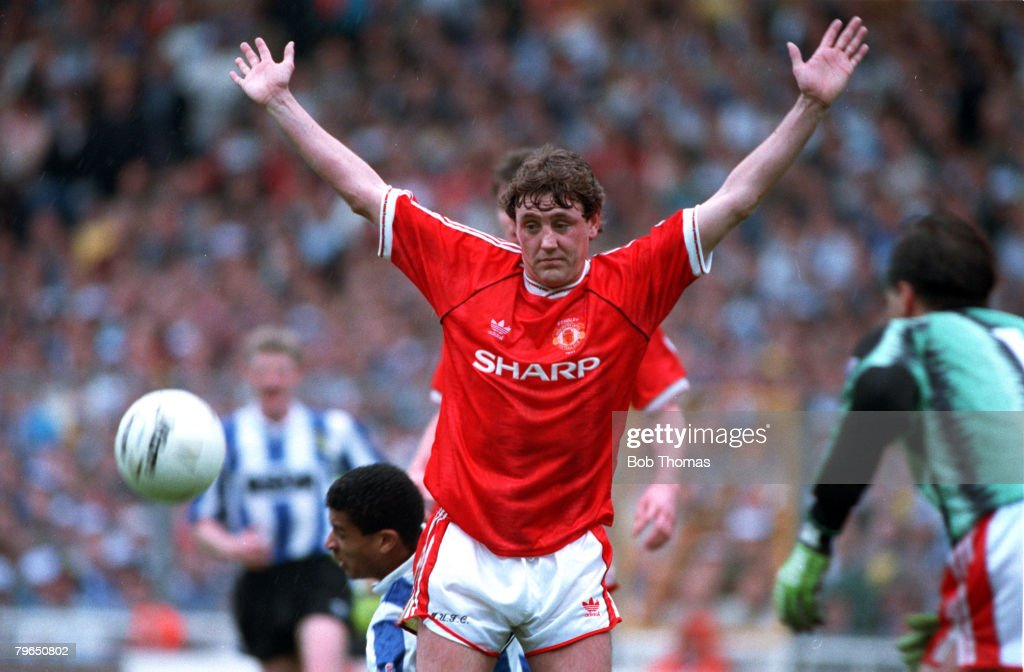 Sport, Football, Rumbelows Cup Final, Wembley, 21st April 1991, Manchester United 0 v Sheffield Wednesday 1, Manchester United's Steve Bruce raises his arms in innocence after a challenge on Sheffield Wednesday's Paul Williams