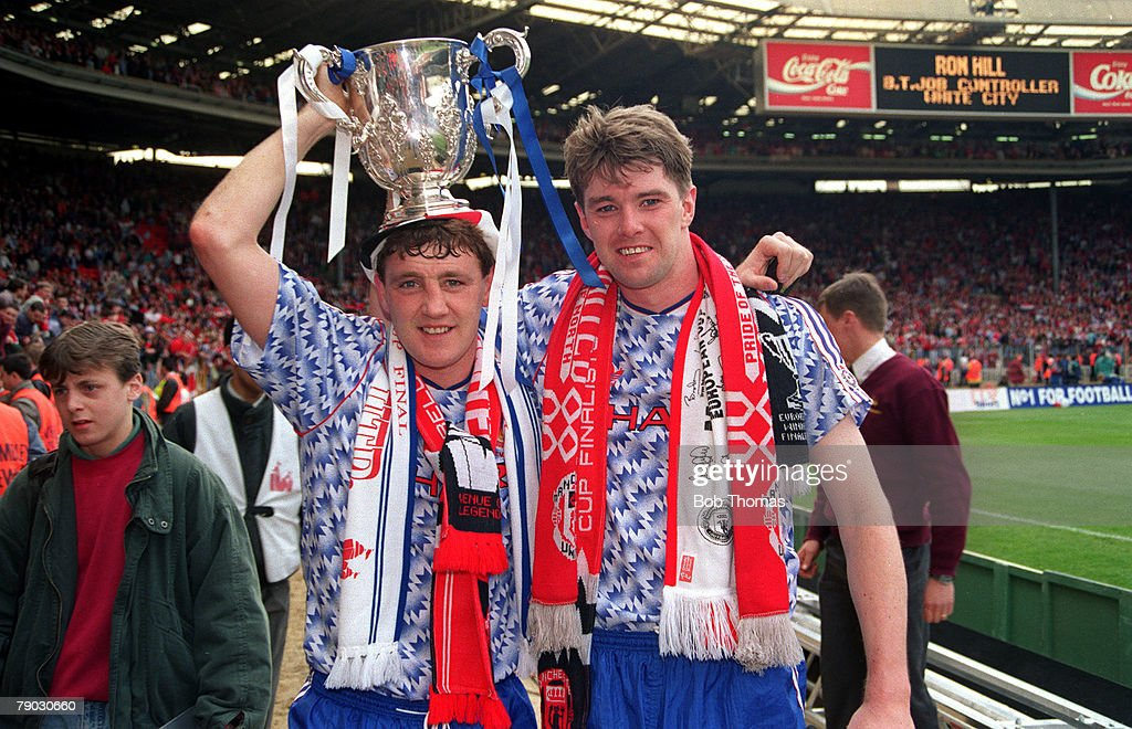 Sport. Football. Rumbelows League Cup Final. Wembley, London, England. 12th April 1992. Manchester United 1 v Nottingham Forest 0. Manchester United captain Steve Bruce (left) celebrates with his team-mate Gary Pallister as they hold the trophy aloft. : News Photo