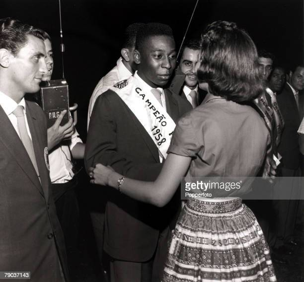 Sport Football Santos and Brazil star Pele wearing the Champions sash is congratulated by a female admirer as Santos become the Sao Paulo champions...