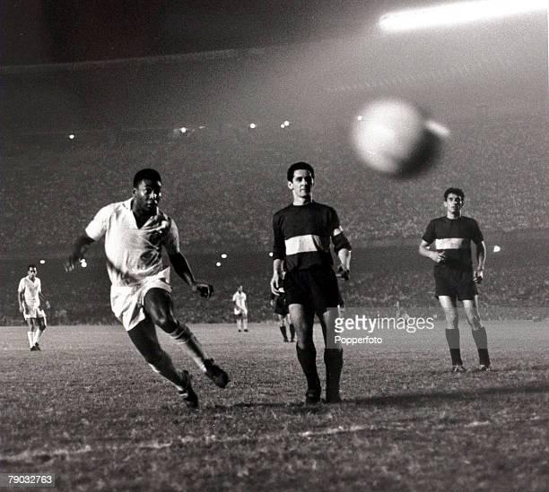 Sport Football South American Championship September 1963 Santos v Boca Juniors Pele of Santos watching the ball with Boca Juniors defenders Pele was...