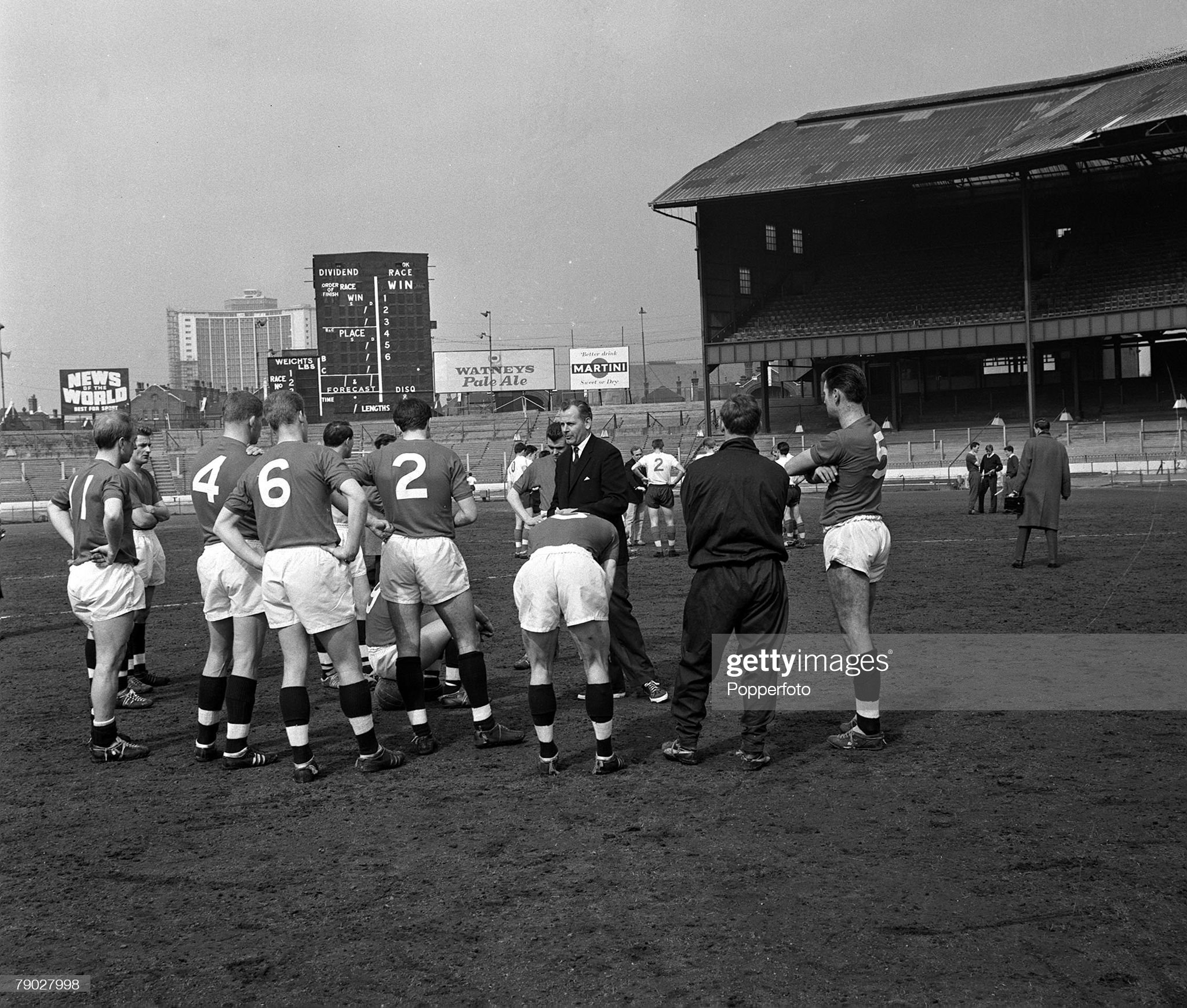 Sport. Football. Stamford Bridge, Chelsea, London. 20th March 1962. England Manager Walter Winterbottom talks to his players during half time of the England Seniors v England Under 23's trial match. : News Photo