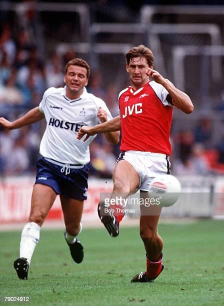 Sport Football The Wembley Tournament London England 13th August 1988 Arsenal 4 v Tottenham Hotspur 0 Arsenal's Tony Adams beats Tottenham's Paul...