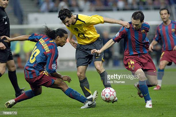 Sport Football UEFA Champions League Final Paris 17th May 2006 Barcelona 2 v Arsenal 1 Arsenal's Cecs Fabregas with Barcelona's Ronaldinho and Andres...
