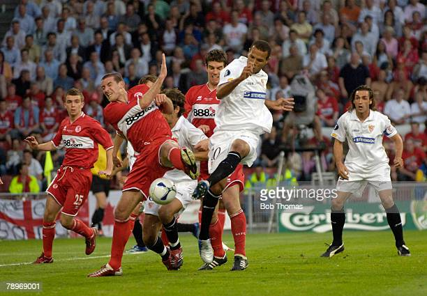 Sport Football UEFA Cup Final Eindhoven 10th May 2006 Middlesbrough 0 v Sevilla 4 Middlesbrough's Franck Queudrue with Sevilla's Luis Fabiano