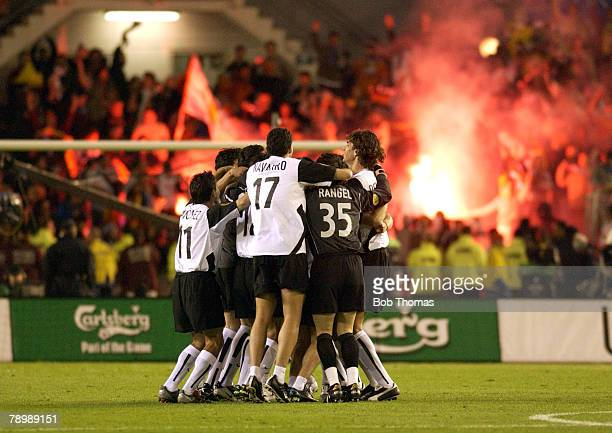 Sport Football UEFA Cup Final Gothenburg 19th May 2004 Valencia CF 2 v Olympic Marseille 0 Valencia players celebrate victory as the fans set off red...