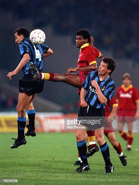 Sport Football UEFA Cup Final Second Leg Rome Italy 22nd May 1991 Roma 1 v Inter Milan 0 Roma's Santos Aldair wins the ball between Inter's Sergi...