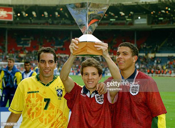 Sport Football Umbro Cup at Wembley pic 11th June 1995 England 1 v Brazil 3 Brazil's leftright Edmundo Juninho and Ronaldo celebrate with the trophy