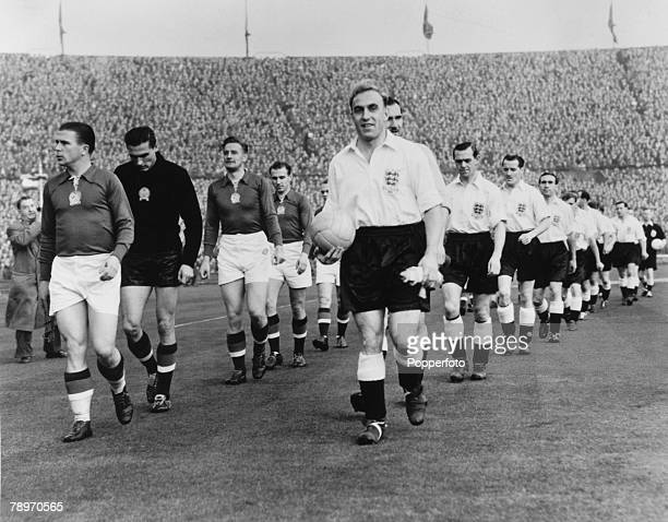 Sport Football Wembley 25th November 1953 England 3 v Hungary 6 The two teams are led onto the pitch by their captains Ferenc Puskas of Hungary and...