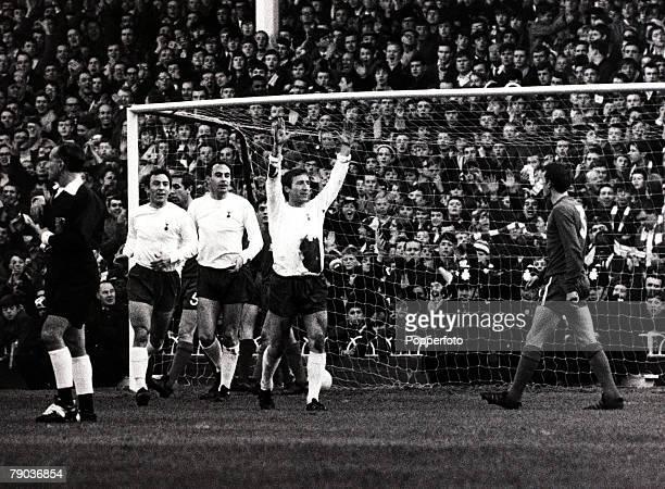 Sport Football White Hart Lane London England circa 1969 League Division One Tottenham Hotspur v Chelsea Tottenham Hotspur's Cliff Jones raises his...