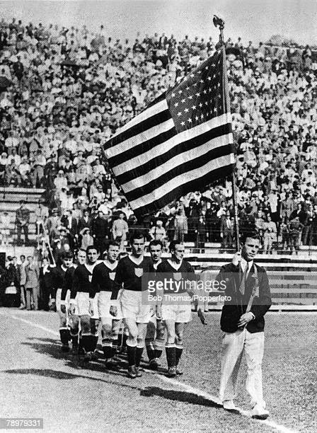 Sport Football World Cup EighthFinal Rome Italy 27th May Italy 7 v USA 1 The American team follow the stars and stripes bearer onto the field before...