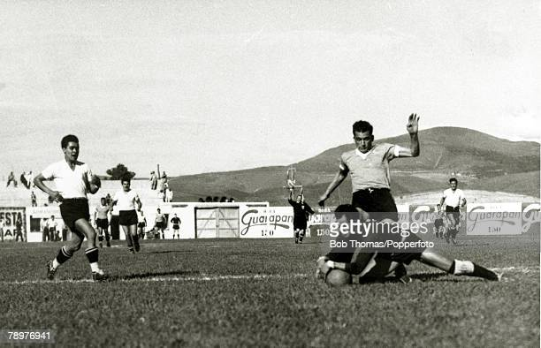 Sport Football World Cup Finals 2nd July 1950 Bela Horizonte Brazil Uruguay 8 v Bolivia 0 Uruguay forward Julio Perez is thwarted by Bolivian...