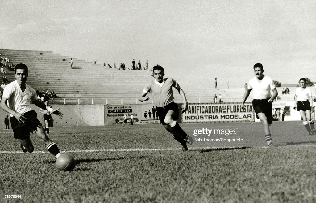 Sport. Football. World Cup Finals. 2nd July 1950. Bela Horizonte, Brazil. Uruguay 8. v Bolivia 0. Uruguay forward Julio Perez, (centre) races through the Bolivian defence in the match which attracted a modest crowd of just 10,000 people. Uruguay's goals w : News Photo