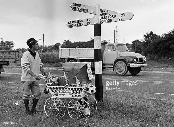Sport Football World Cup Finals 7th July 1966 Cobham England A Swiss football supporter travelling with his belongings in a pram walks along the...