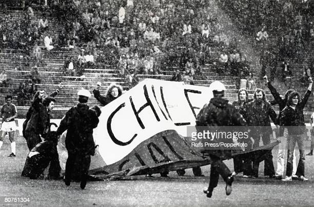 Sport Football World Cup Finals Berlin West Germany 22nd June 1974 Chile 0 v Australia 0 During heavy rain demostrators against the Government of...