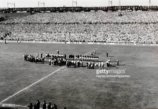 Sport Football World Cup Finals July 1954 Germany v Hungary Both teams lineup at the start of the match Above the crowded stand a railway train passes