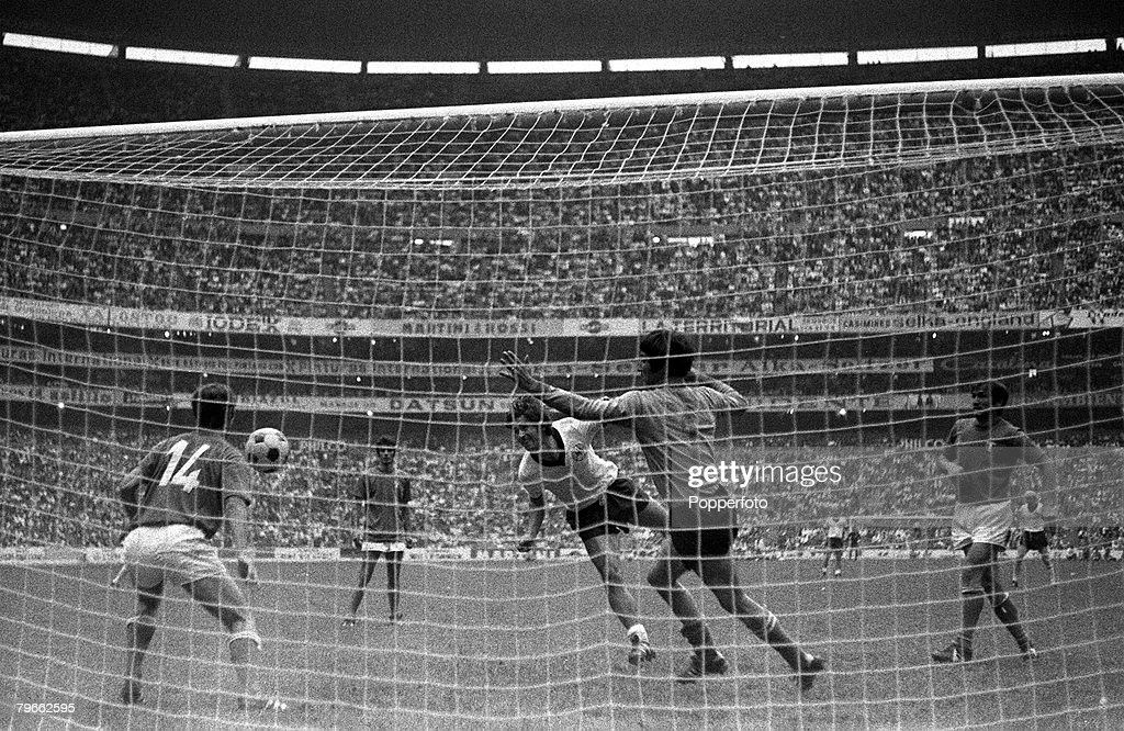 Sport, Football, World Cup Finals, Mexico City, 17th June 1970, Semi Final, Italy 4 v West Germany 3 (after extra time), West Germany's Gerd Muller (centre) scores the third goal past Italy goalkeeper Enrico Albertosi and Gianni Rivera (14) : News Photo