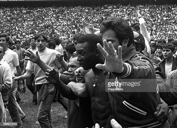 Sport Football World Cup Finals Mexico City 21st June 1970 World Cup Final Brazil 4 v Italy 1 Brazil's Pele is hustled off the pitch after his side's...