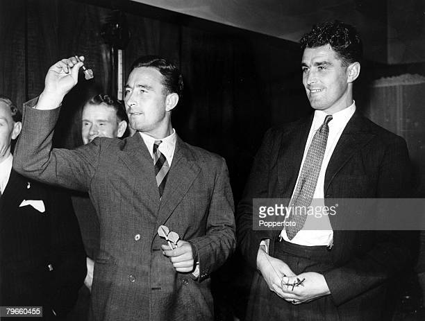 Sport Football/Cricket London England 19th September 1947 Dennis Compton watched by his brother Leslie playing darts for a charity at a London Hotel
