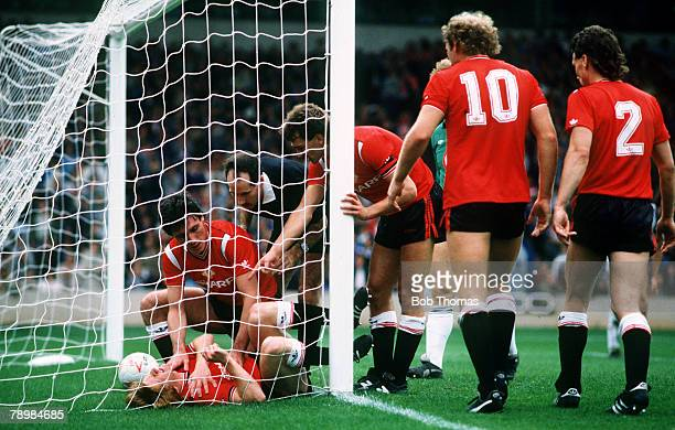 21st September 1985 Division 1 West Bromwich Albion 1 v Manchester United 5 Manchester United's Gordon Strachan lies injured after colliding with a...