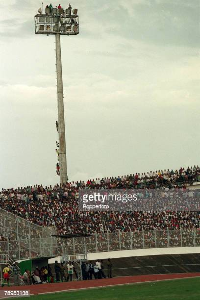 6th April 1997 World Cup Qualifier Cameroon 1 v Zimbabwe 0 Fans climb the floodlight pylon for a better view of the game
