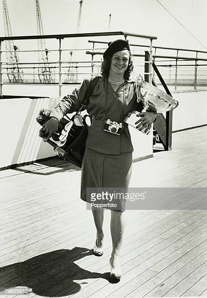 Sport Golf 26th June 1947 American golfer Mildred 'Babe' Didrickson Zaharias holds onto the Ladies Open trophy she won and poses abroad the liner...